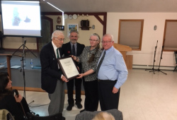 Left to right: The late George O'Connor, past-president of the BIS PEI; Mary Ellen Callaghan, current president; Patrick Fitzgerald, also a past-president; and the late Dr. Brendan O'Grady, BIS Patron, at the BIS in 2017. O'Connor was accepting the Dr. Brendan O'Grady Celtic Pathway Award at the BIS. Photo courtesy of Mary Ellen Callaghan.