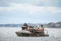 four shellfish harvesters on an oyster boat