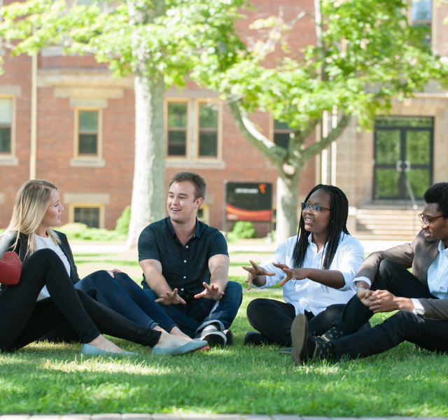 Students sitting in the quad