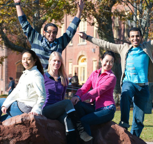 international students sitting in front of the university quad